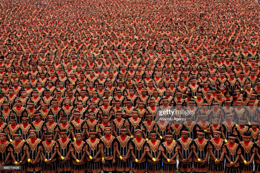 10.447 male dancers perform the Saman dance, one of Aceh's traditional dance at Gayo Lues, Aceh Province, Indonesia on August 12, 2017. Saman dance is a Gayo tribe dance used to convey messages of kindness and since 2011 registered in Unesco as world heritage.