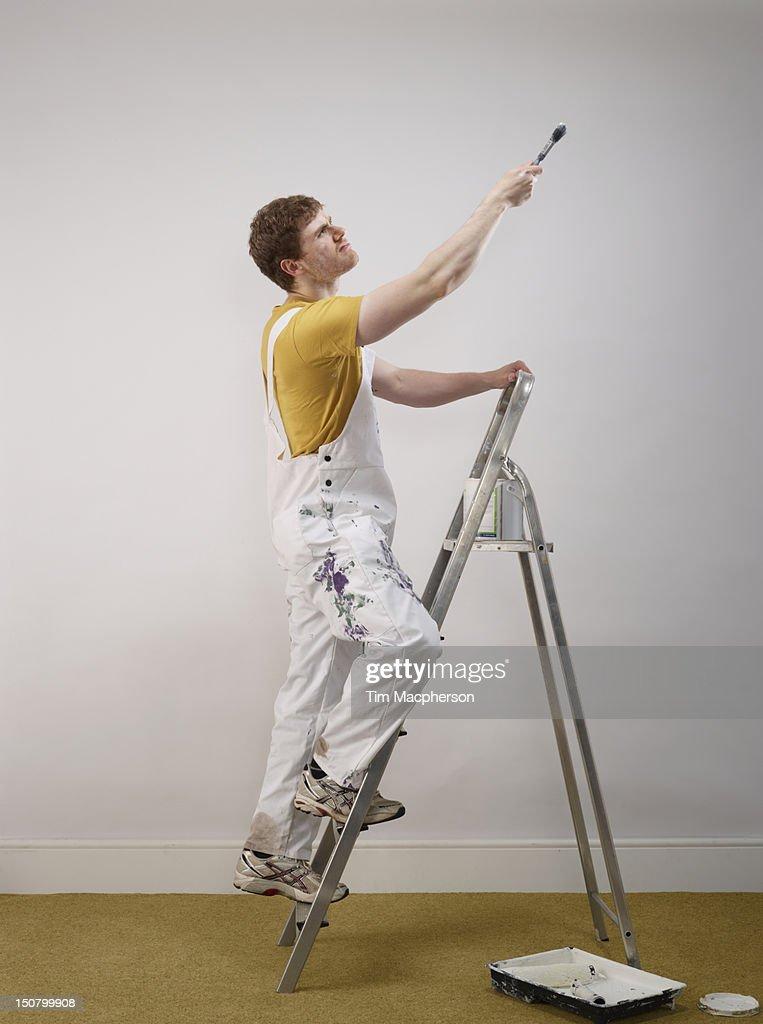 male decorator painting