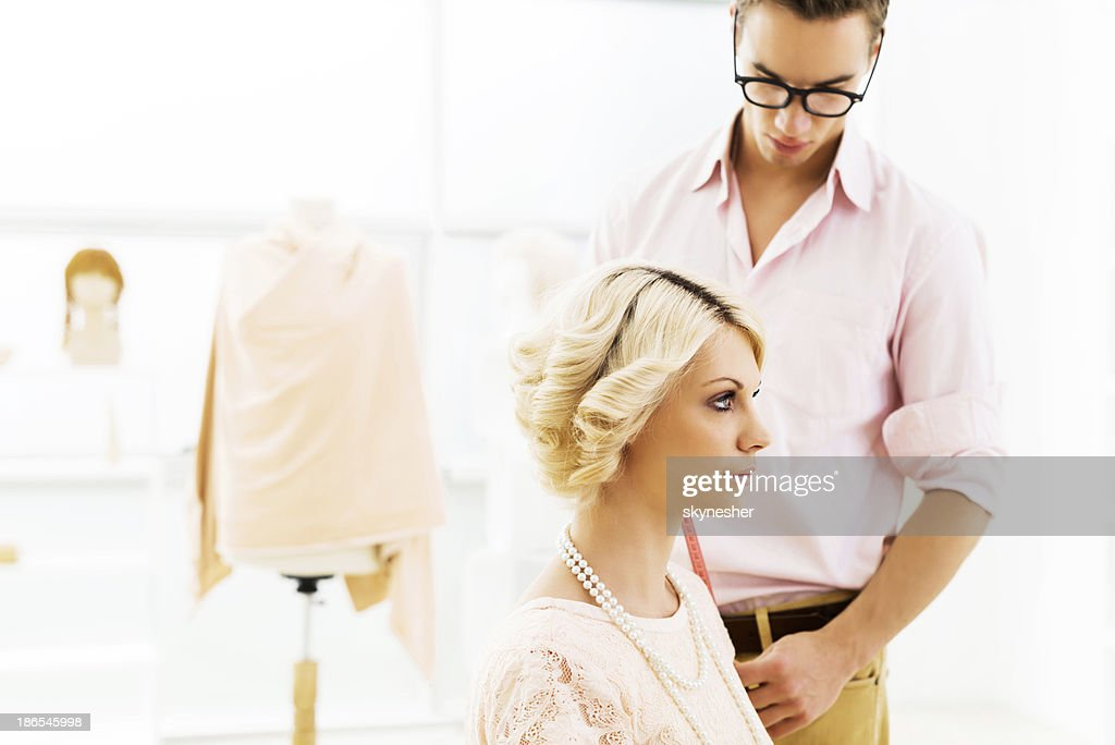 Male designer taking measurements. : Stock Photo