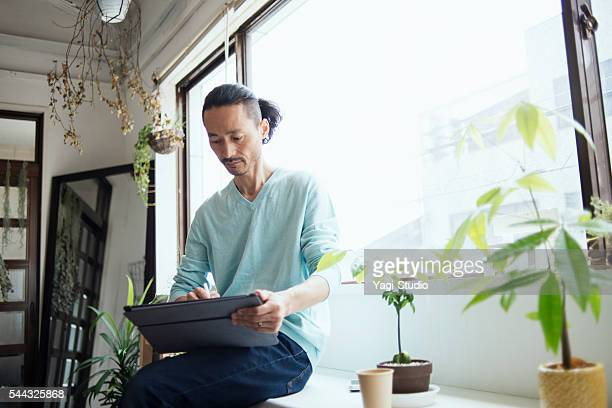 Male designer working with digital tablet in design studio