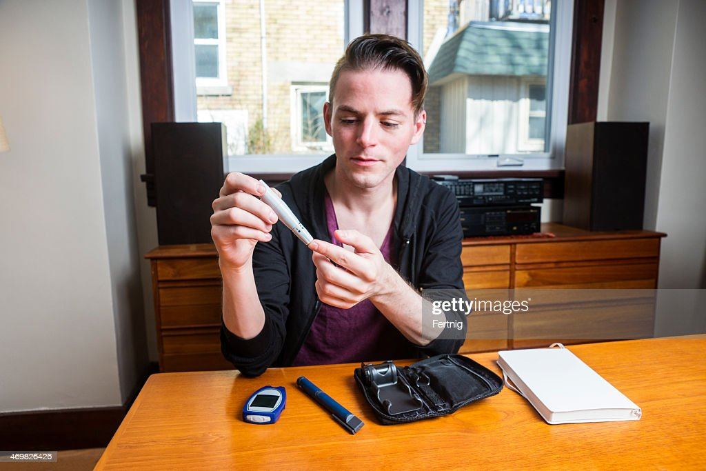 Male diabetes patient checking his blood sugar