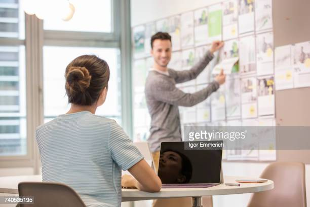 Male digital designer preparing mood board in office