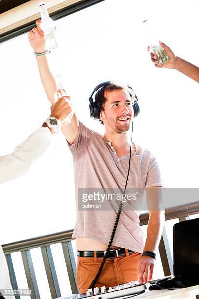 Male DJ Playing Music At Outdoor Venue