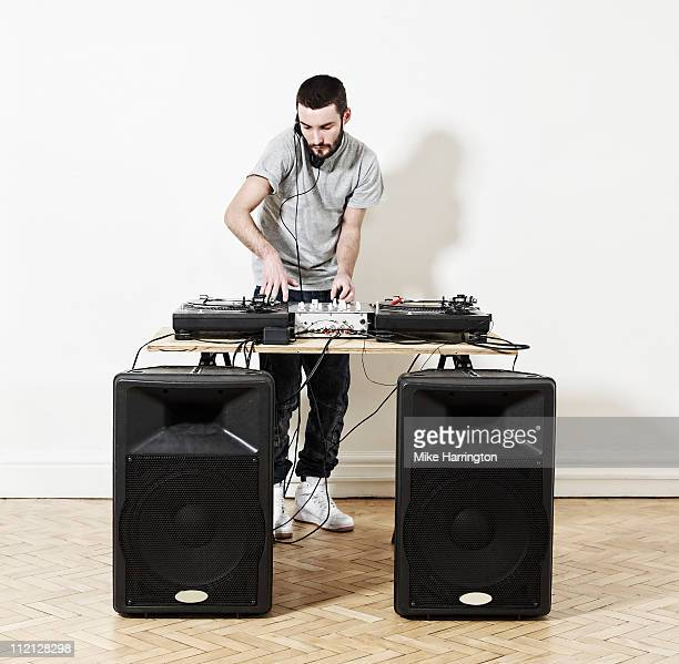 Male DJ Using Decks