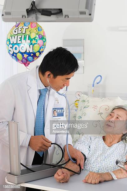 Male doctor checking a patient's blood pressure