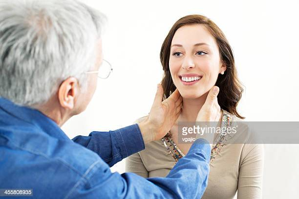 Male Doctor Checking Female Patient Glands