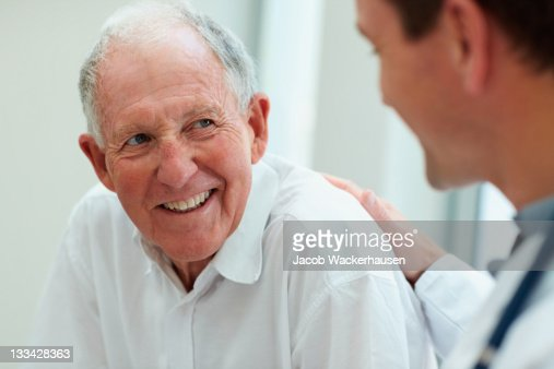 Male doctor discussing with his patient
