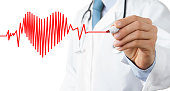 Male doctor drawing heart symbol