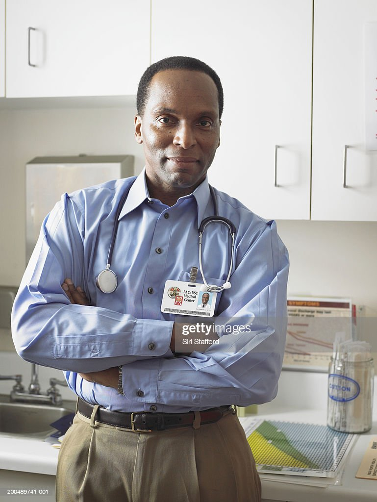 Male doctor in examination room : Stock Photo