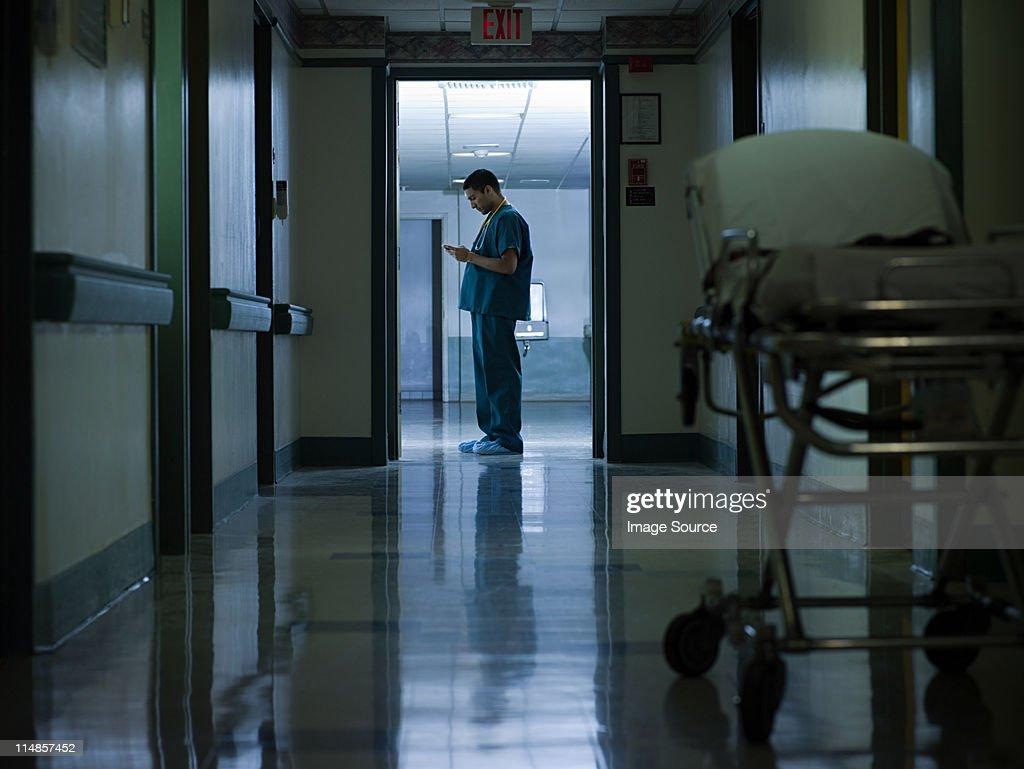 Male doctor in hospital corridor