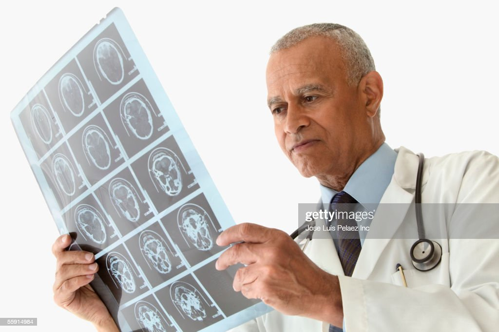 Male doctor looking at CT Scan : Stock Photo