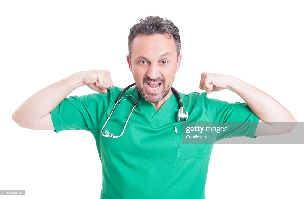 Male doctor looking powerful : Stock Photo