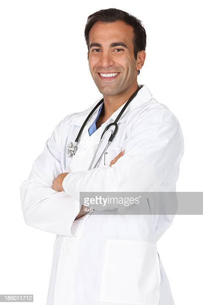 Male doctor standing with his arms crossed