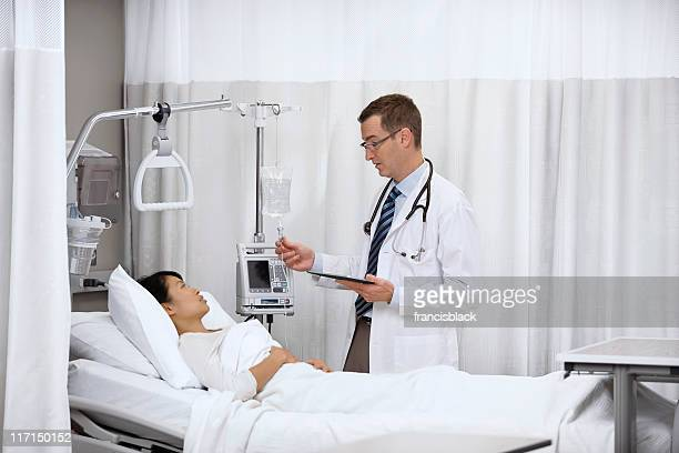 Male doctor visiting young female patient