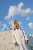 Male doctor wearing bag over head