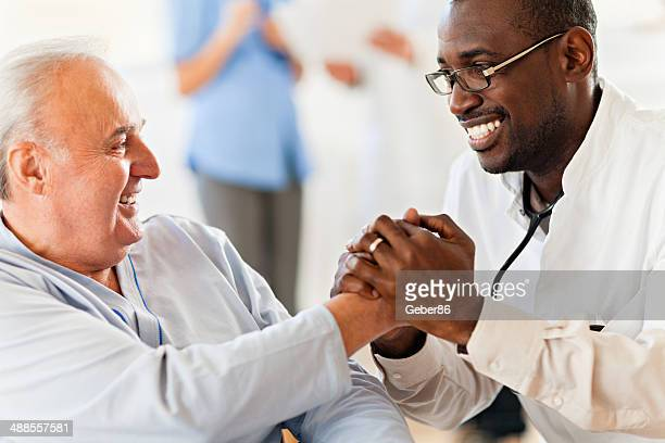 Male doctor with senior patient