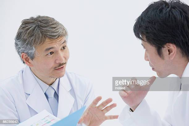 Male doctors talking