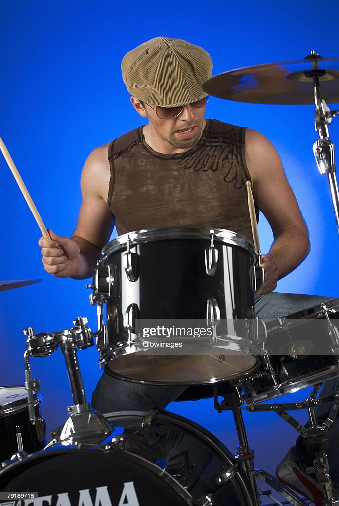 Male drummer playing drums : Stock Photo