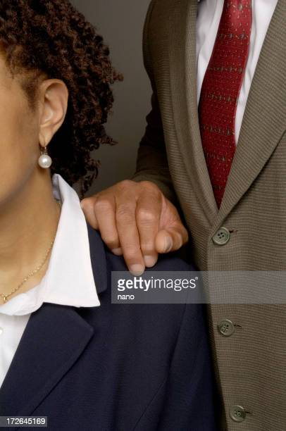 Male employee inappropriately touching female co-worker