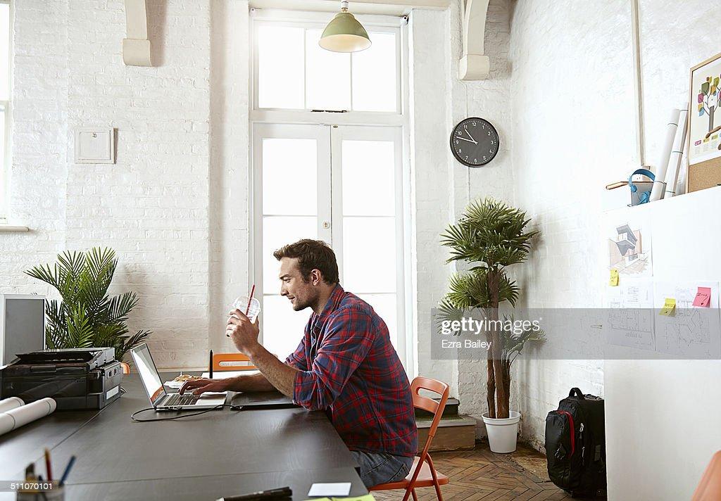 Male employee working in a creative office.