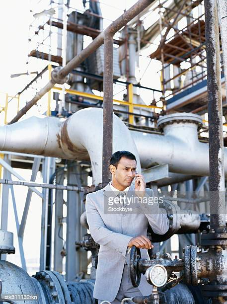 male engineer talking on a mobile phone