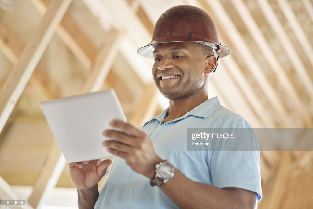 Male Engineer Using Digital Tablet At Construction Site : Stock Photo