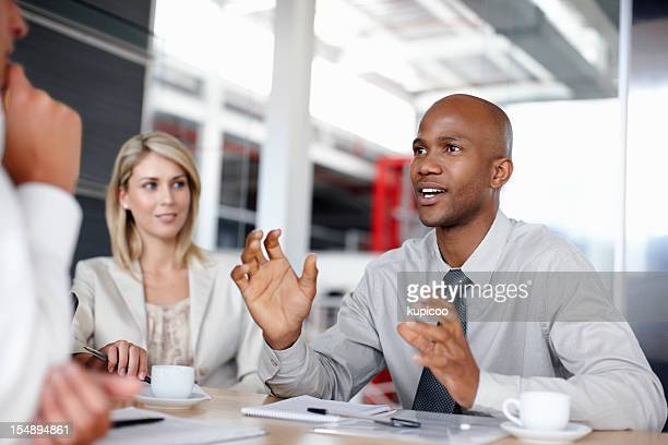 Male executive explaining business strategy to colleagues