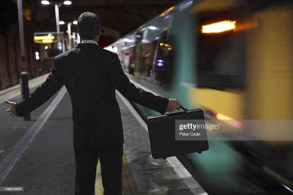 male executive missing train : Stock Photo
