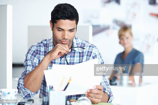 Male executive reading documents