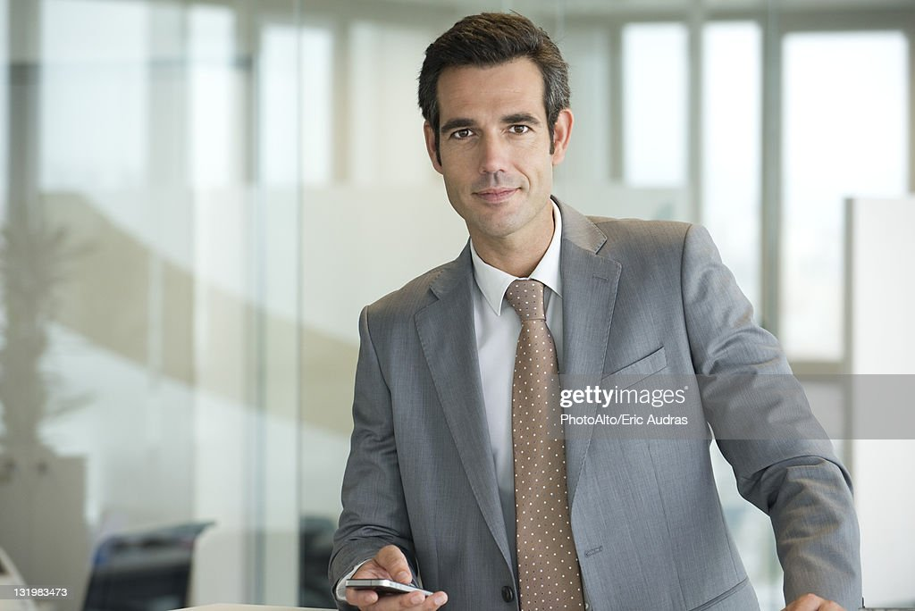 Male executive using cell phone, portrait