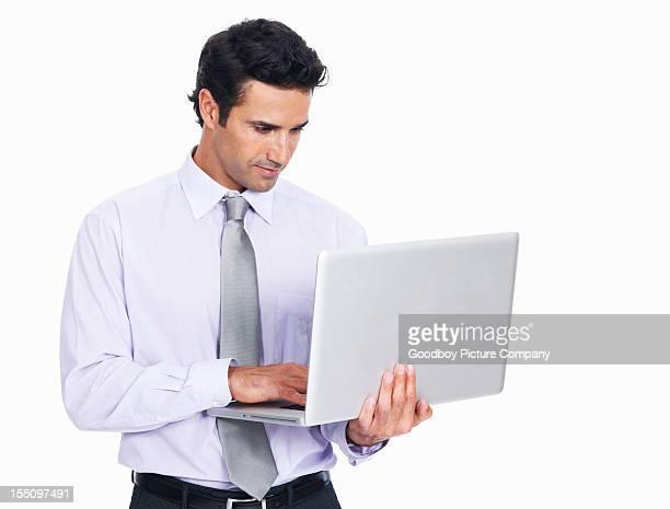 Male executive using laptop