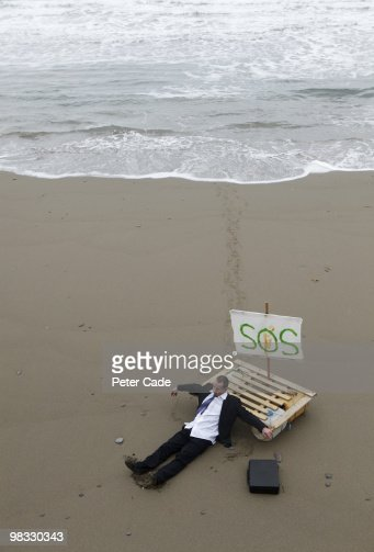 male executive washed up on beach