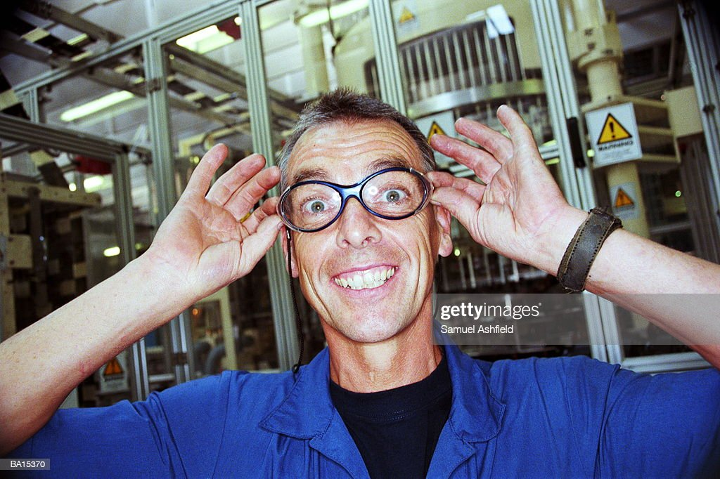Male factory worker adjusting spectacles, portrait : Stock Photo