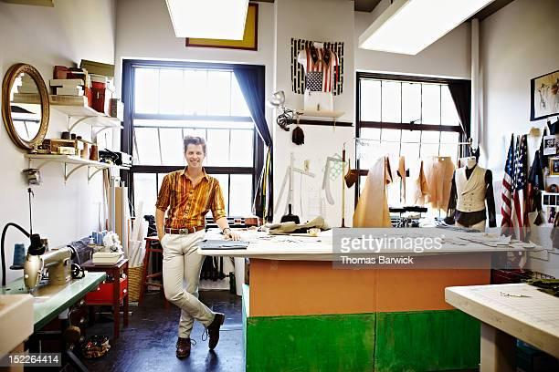 Male fashion designer standing in studio smiling