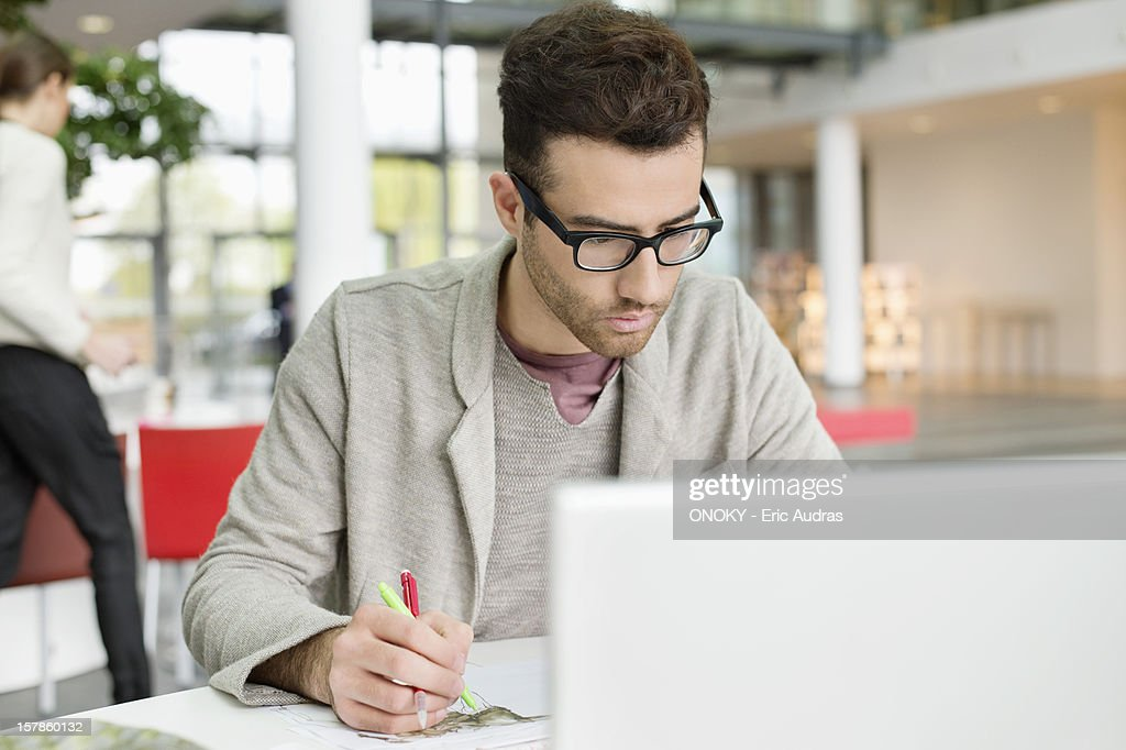 Male fashion designer working in an office : Stock Photo