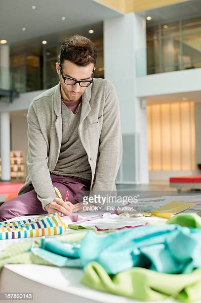 Male fashion designer working in an office