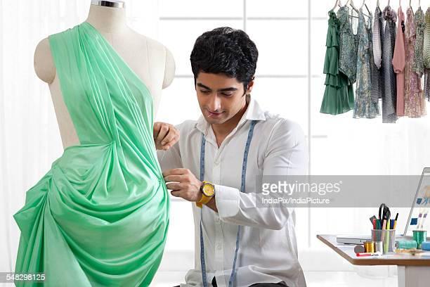 Male fashion designer working in studio