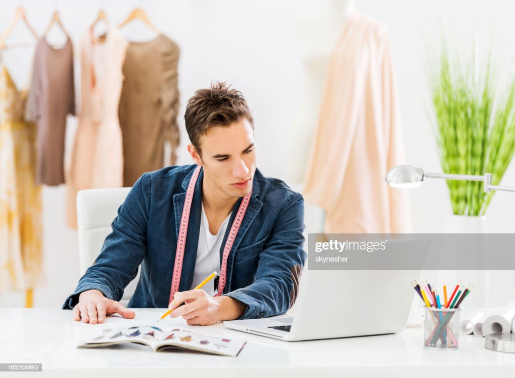 Male fashion designer working. : Stock Photo