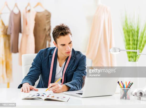 Male fashion designer working.