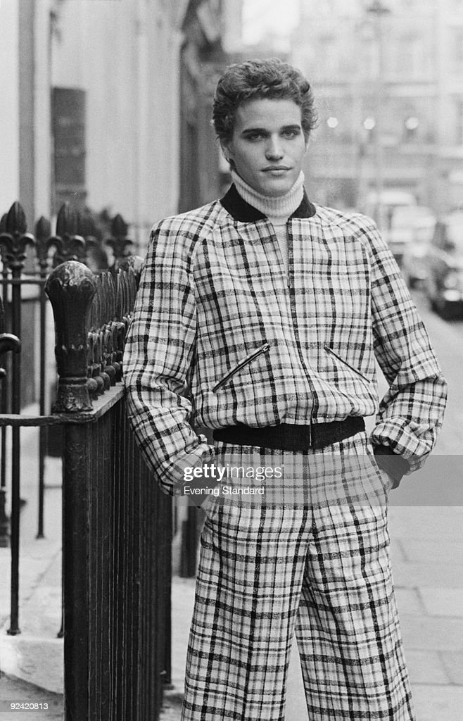 A male fashion model wearing a tartan jacket and trousers over a polo neck jumper, March 1972.