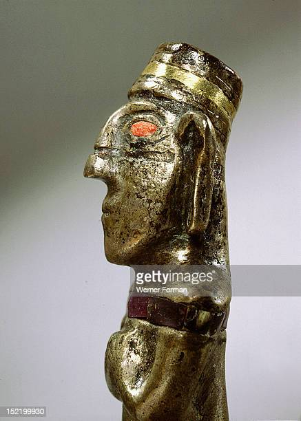 Male figurine cast in silver with unusual inlay of gold stone and pink shell The figure represents an idealised Inca male of elite status as shown by...