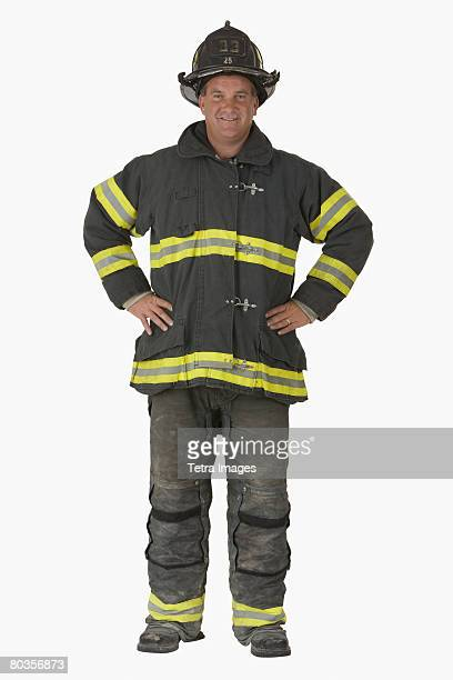 Male firefighter with hands on hips
