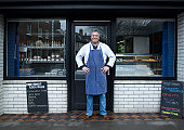 Male Fishmonger Standing Outside Shop Front