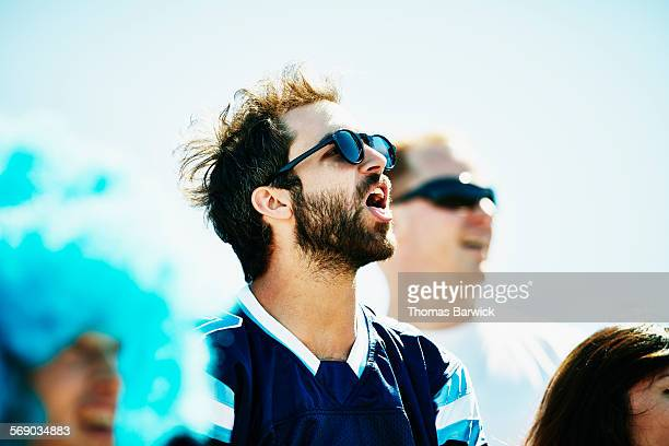 Male football fan yelling during football game