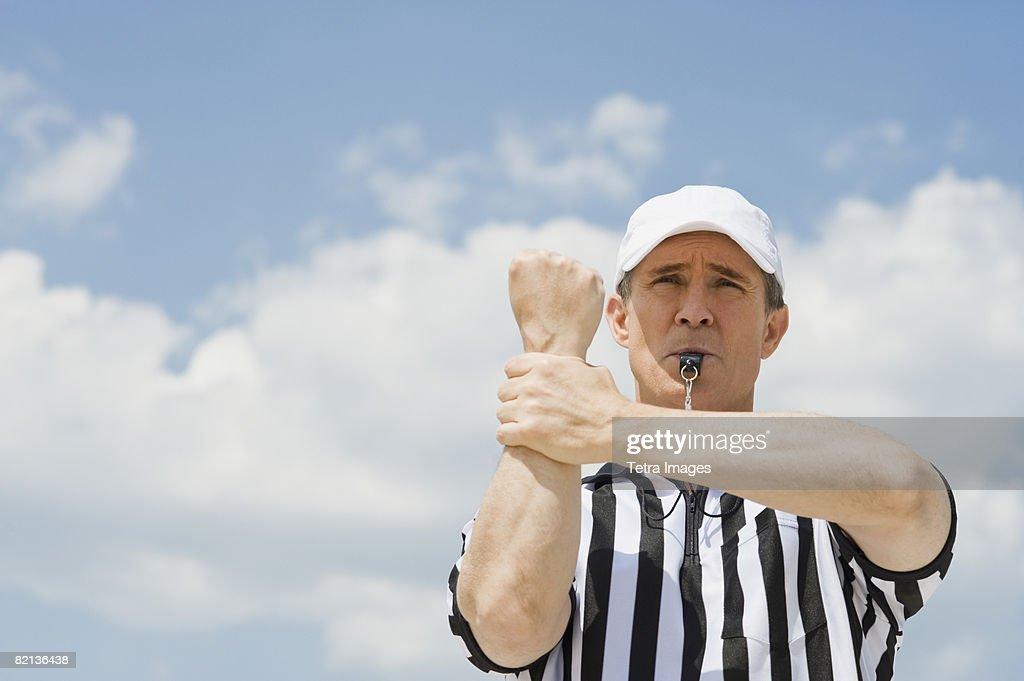 Male football referee making holding call : Stock Photo
