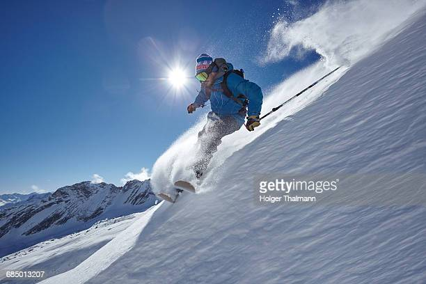 Male freestyle skier skiing down mountainside, Zugspitze, Bayern, Germany