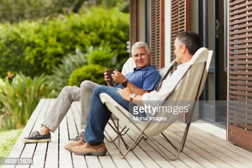 Male friends spending leisure time at yard
