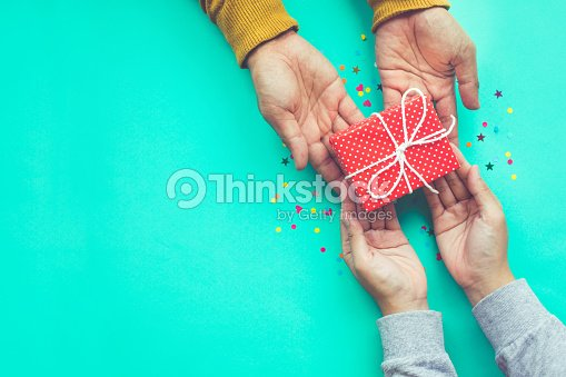 Male gives a gift to female with copy space : Stock Photo