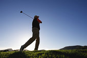 Male golfer, low angle view