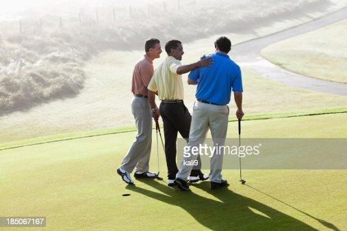 Male golfers bonding